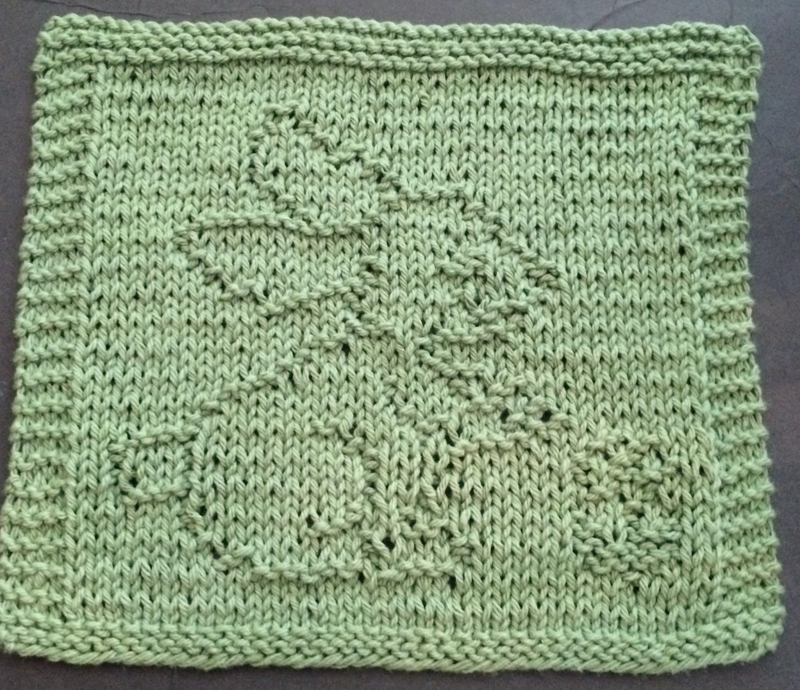 Knitted Dishcloth Patterns For Easter : DigKnitty Designs: Bunny with Flower Knit Dishcloth Pattern