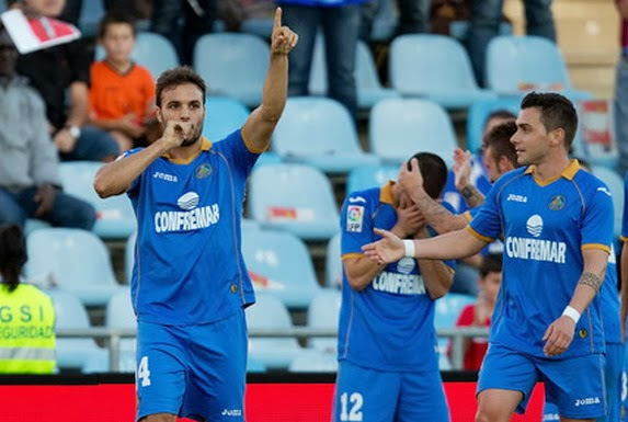 Getafe player Pedro León celebrates after scoring the opening goal against Real Betis