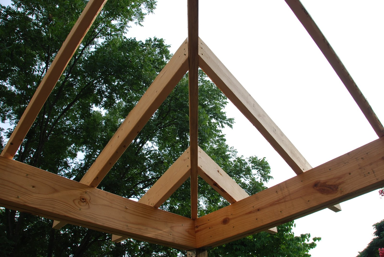The corner of a hipped roof is made up of a center hip rafter and