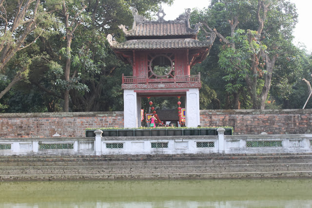 Third Courtyard of the temple with the Well of Heavenly Clarity and the red Constellation of Literature pavilion at Temple of Literature in Hanoi, Vietnam