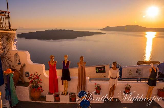 Santorini Sunset Greece by Monika Mukherjee