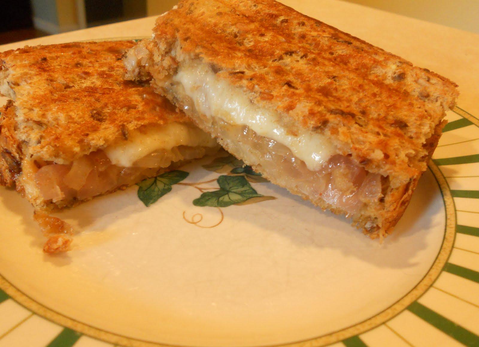 caramelized onion and cheddar sandwich tomato pesto and mozzarella