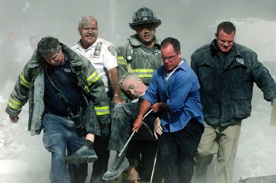 First responders carry the lifeless body of Father Michael Judge from the wreckage of the World Trade Center on 9/11