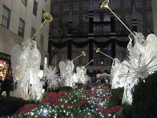 Angels with trumpets, lit at night, Rockefeller Center, New York, New York