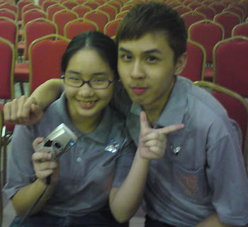 Me and Tze Yit. You think he's handsome?