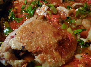 Chicken on top of Sauce in Pan