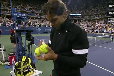 Rafael Nadal tennis balls autograph win round one Golubev photos pictures images screencaps screengrabs pics