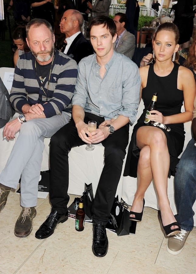 Jennifer Lawrence and  Nicholas Hoult drinking alcohol at a fashion show in Monaco
