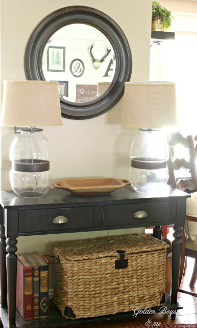 Console table with round mirror and Target lamps in family room-www.goldenboysandme.com