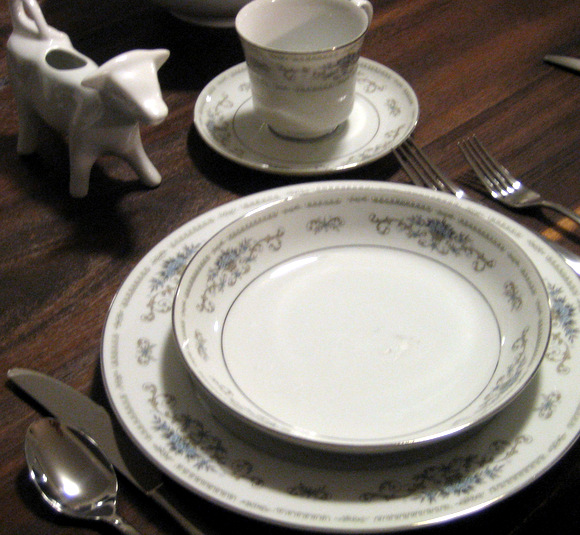 I love this cute china pattern with blue floral trim and silver accents.