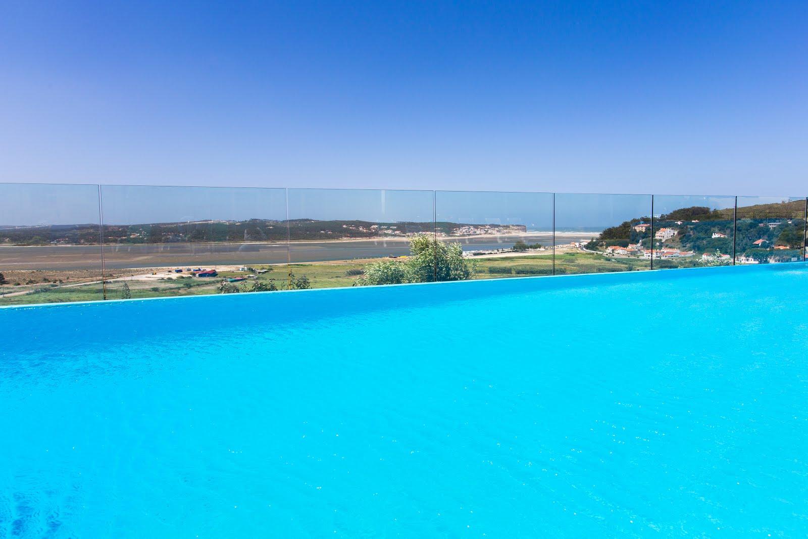 Heated pool overlooking Obidos lagoon and the sea behind