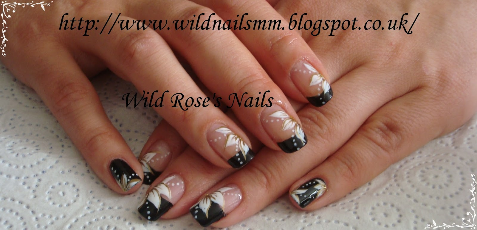 Wild Rose S Nails Black Tips White Flowers And Gold