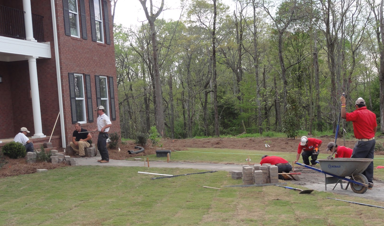 College Pro Landscaping Installing The Front Sidewalk Pavers