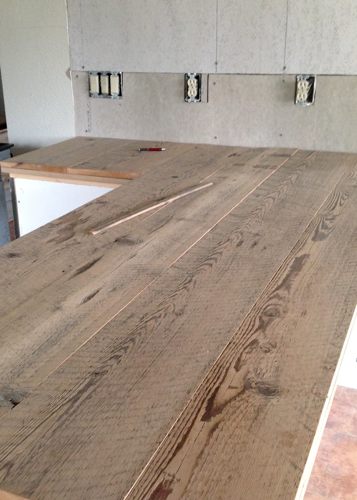DIY Reclaimed Wood Countertop - gluing and nailing down reclaimed wood  boards - DIY Reclaimed Wood Countertop Averie Lane: DIY Reclaimed Wood