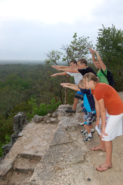 Trying to keep my family from jumping off the top of the Pyramid Temple of Nohoch Mul in Coba Mexico