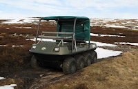 Six-wheeled motor vehicle in mud.
