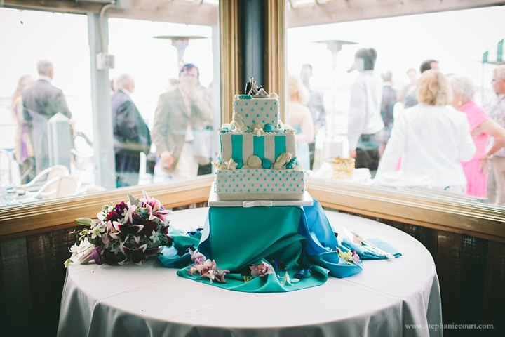 """turquoise sea inspired wedding cake"""