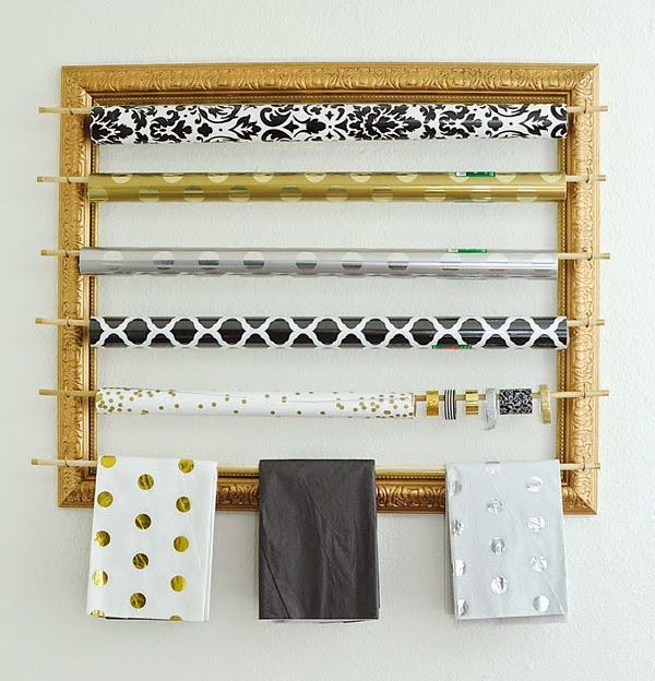 This blogger took a big frame from a thrift store and turned it into a chic gold gift wrapping organizer/station. Looks super easy and gorgeous!