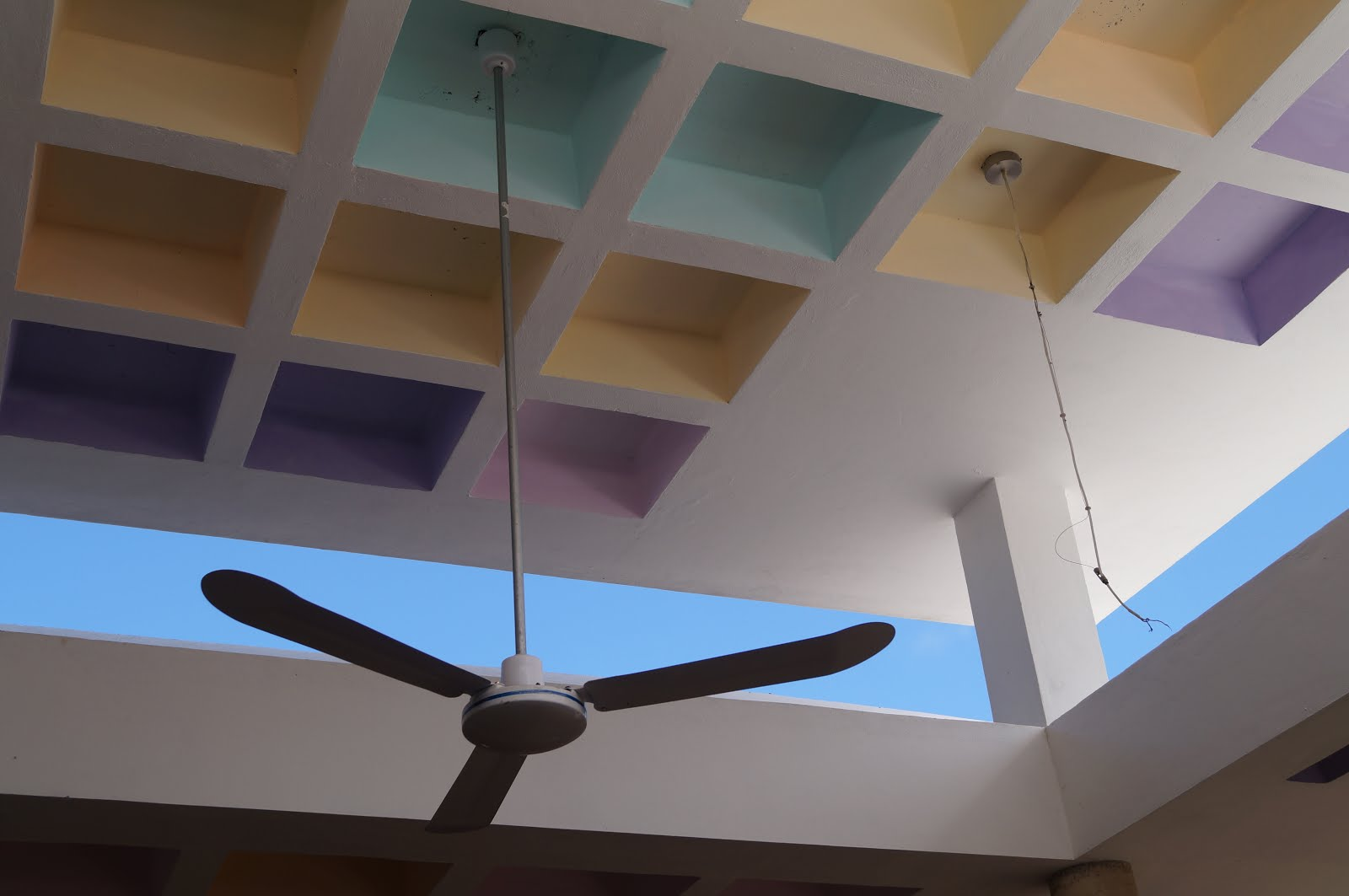 Fan against pastels and sky in Municipal Market of Cozumel