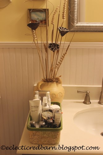 Eclectic Red Barn: Decorated Swiffer container with skin products on counter