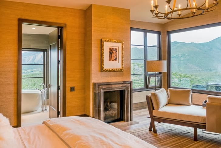Bedroom fireplace in Modern mountain house in Aspen, Colorado