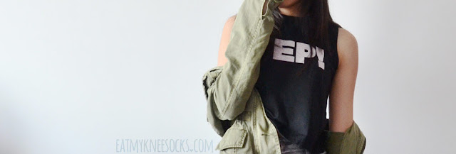 A grunge-style outfit featuring CrossWalk's printed sleeveless high-neck tank top, acid-washed high-waisted Charlotte Russe jeans, and an army green jacket.