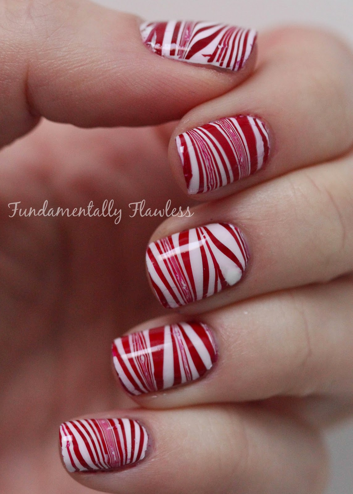 Candy cane watermarble nail art