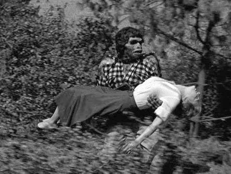 Stuntman Eddie Parker carrying Joanna Moore
