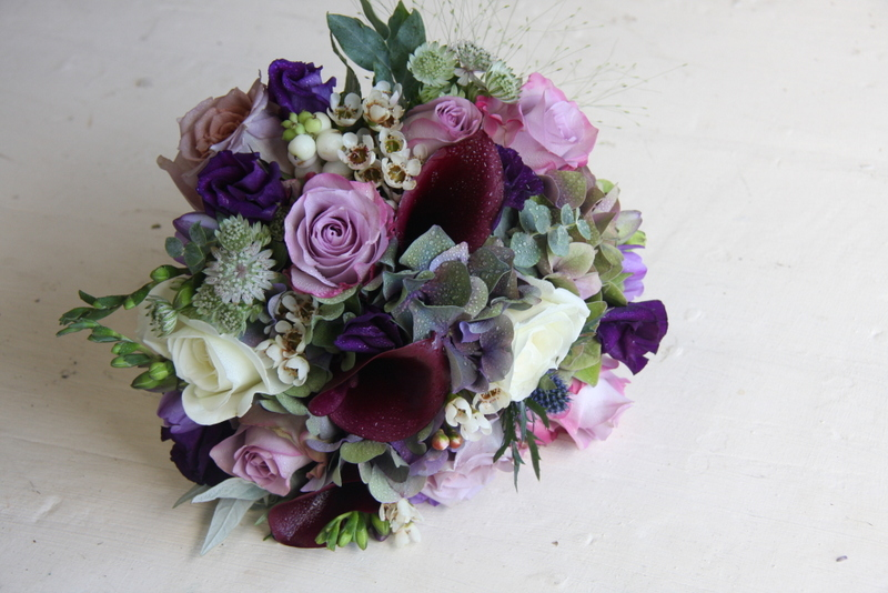 Seasonal Wedding Bouquet In Purple Shades For A September Wedding Day