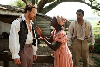 Lupita Nyong'o (centre) as Patsey, Michael Fassbender as Edwin Epps, Chiwetel Ejiofor as Solomon Northup,  in 12 Years a Slave, directed by Steve McQueen