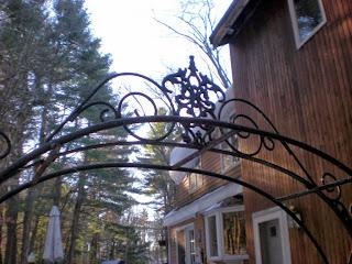 antique wrought iron arbor and gates