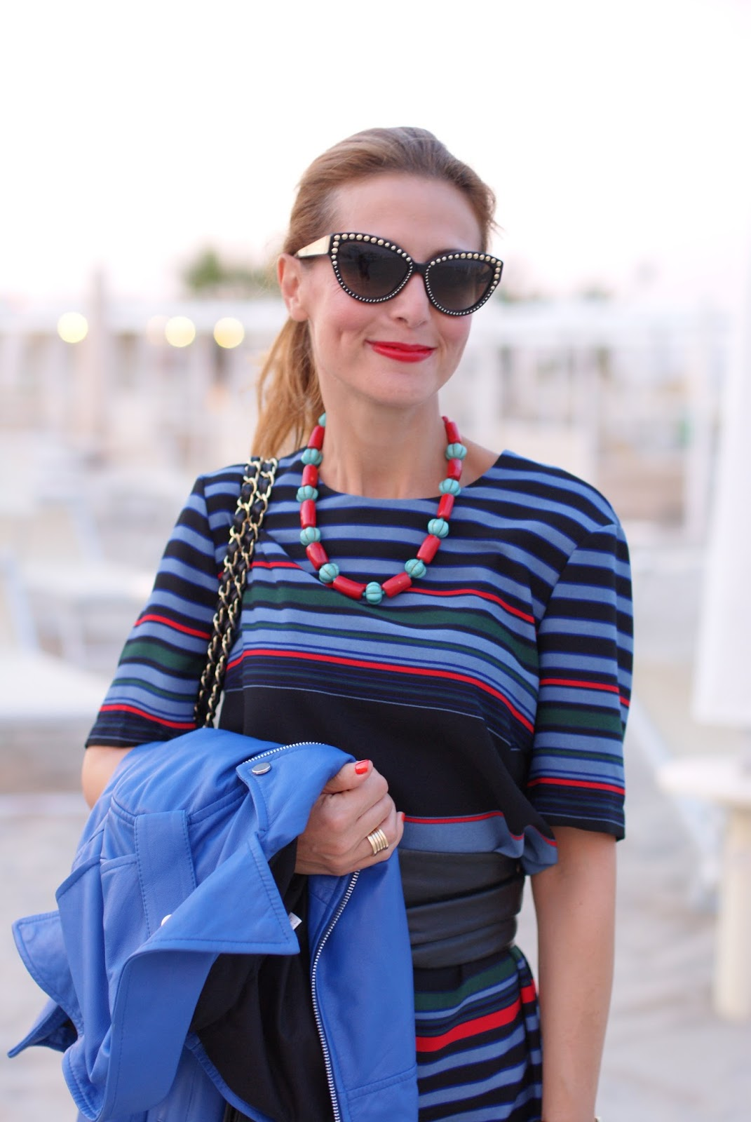 Blue motorbike jacket and striped dress with Chanel 2.55 bag on Fashion and Cookies fashion blog, fashion blogger style
