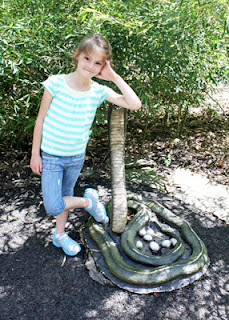 After a few frightening seconds, Tessa realized this snake statue wasn't the real deal and wanted her picture taken with it.