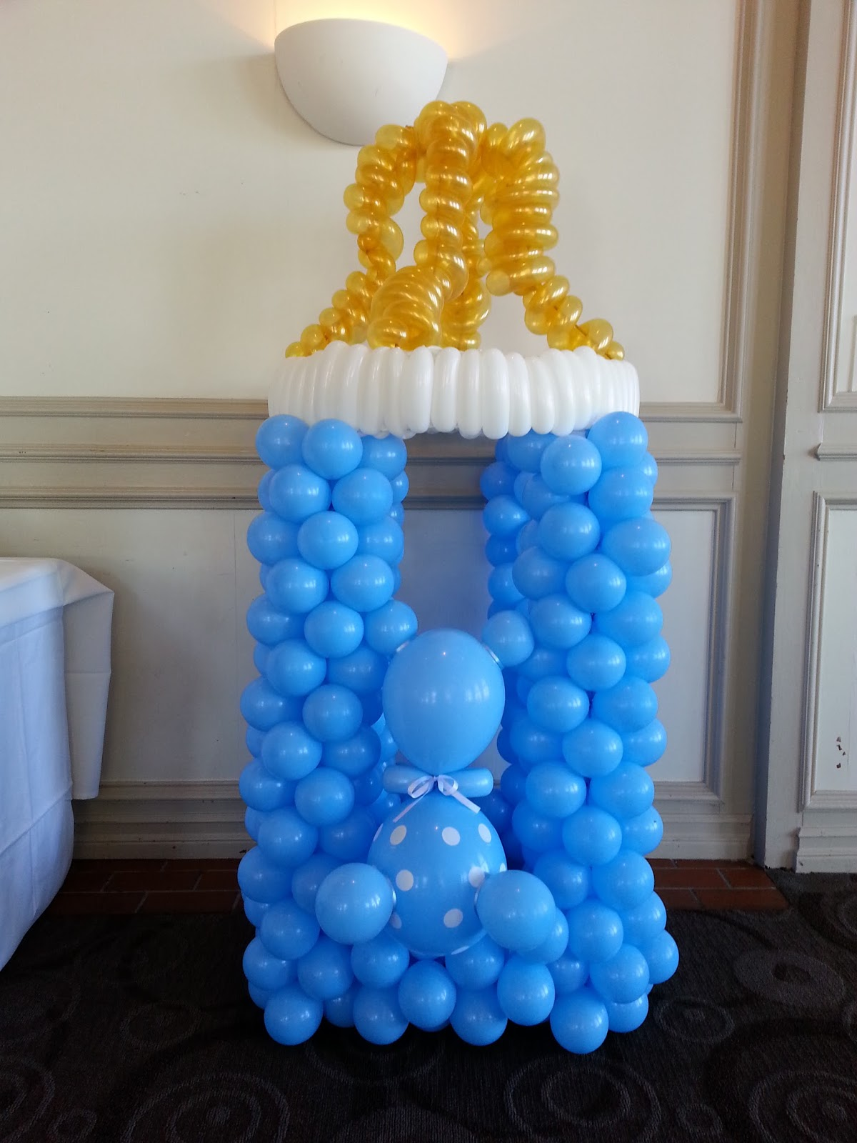 Pop balloons a baby shower for a boy for Baby bottle decoration ideas