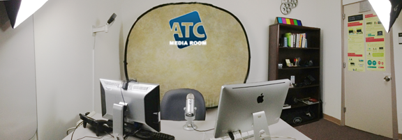 Picture of the Media Room, desk, mac, pc, mic, lights, backdrop