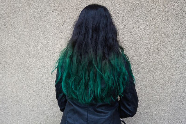 Green hair streaks in black hair