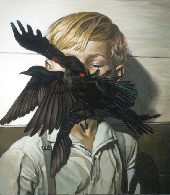 Crows in mouth of a blond boy