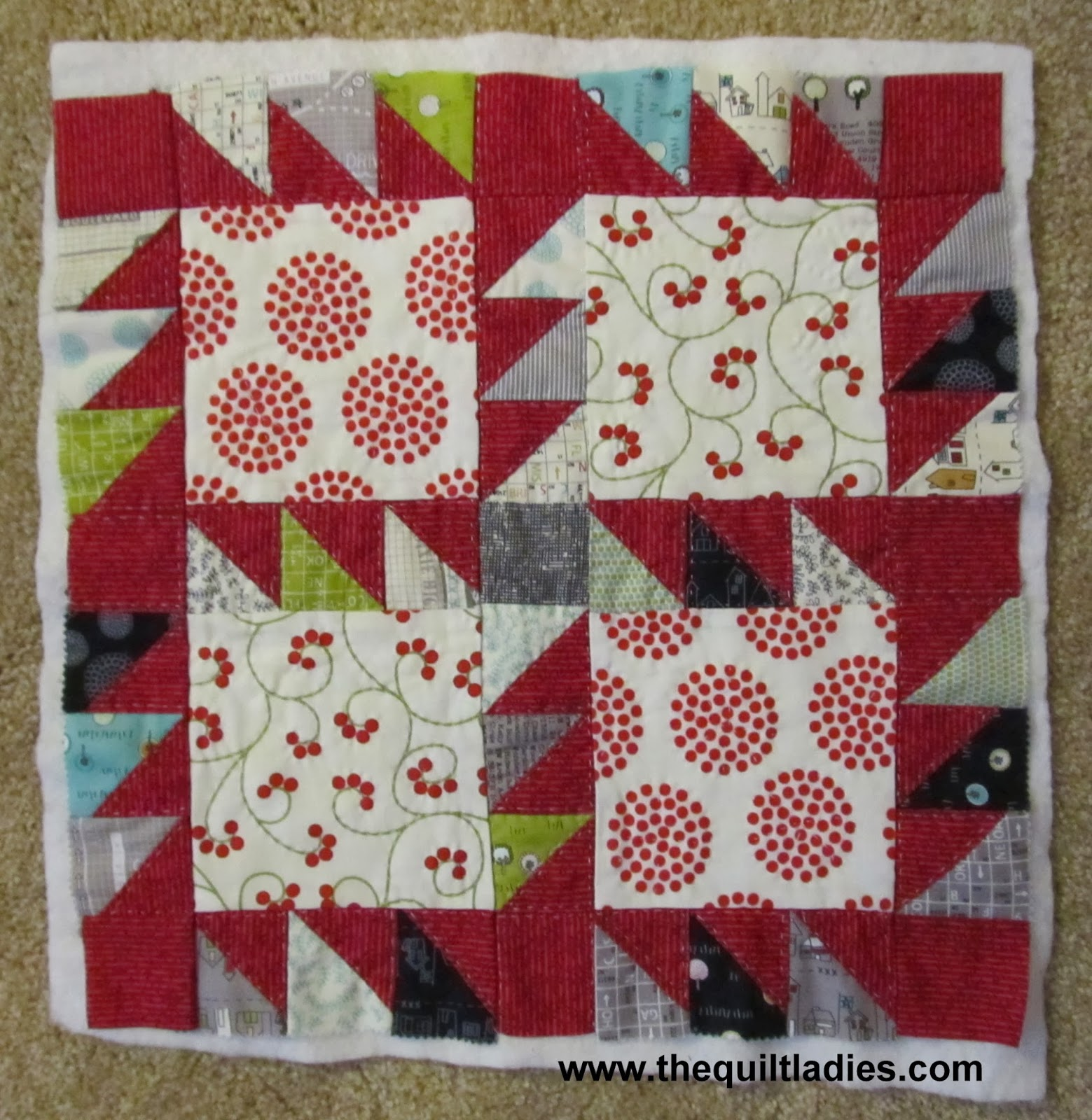 how to make a quilted pillow with triangles and squares