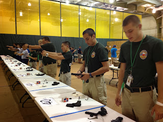 Arthur Herrera (second from right) participates in a competition identifying weapons.