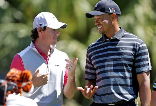© Wilfredo Lee/AP Photo Tiger Woods, right, talks with Rory McIlroy, of Northern Ireland, as they wait to tee off at the 13th tee during the first round play at the Cadillac Golf Championship in Doral, Fla., Thursday March 7, 2013. Wilfredo Lee/AP Photo
