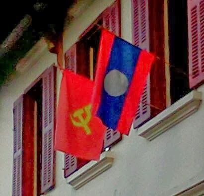 Chinese and Laos flags flying in Luang Prabang, Laos