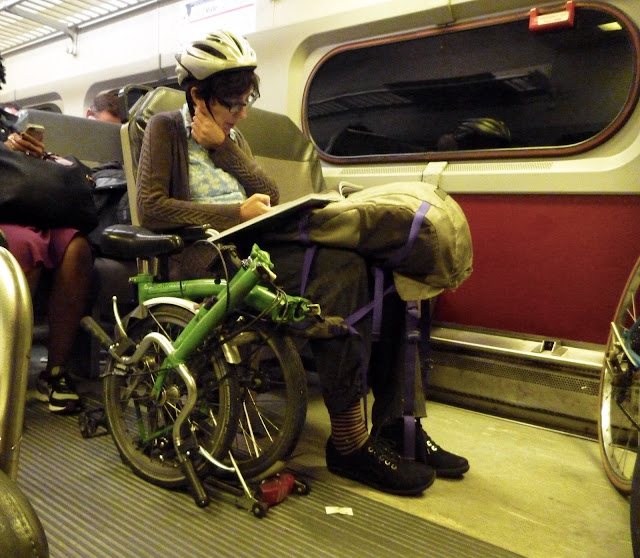 woman on train with bike