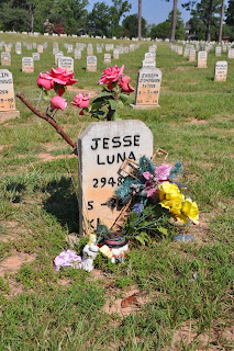 Families leave flowers and trinkets at the cemetery.