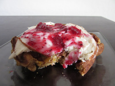 Pumpkin Spice Waffle topped with cheddar, sliced deli chicken and cranberry sauce