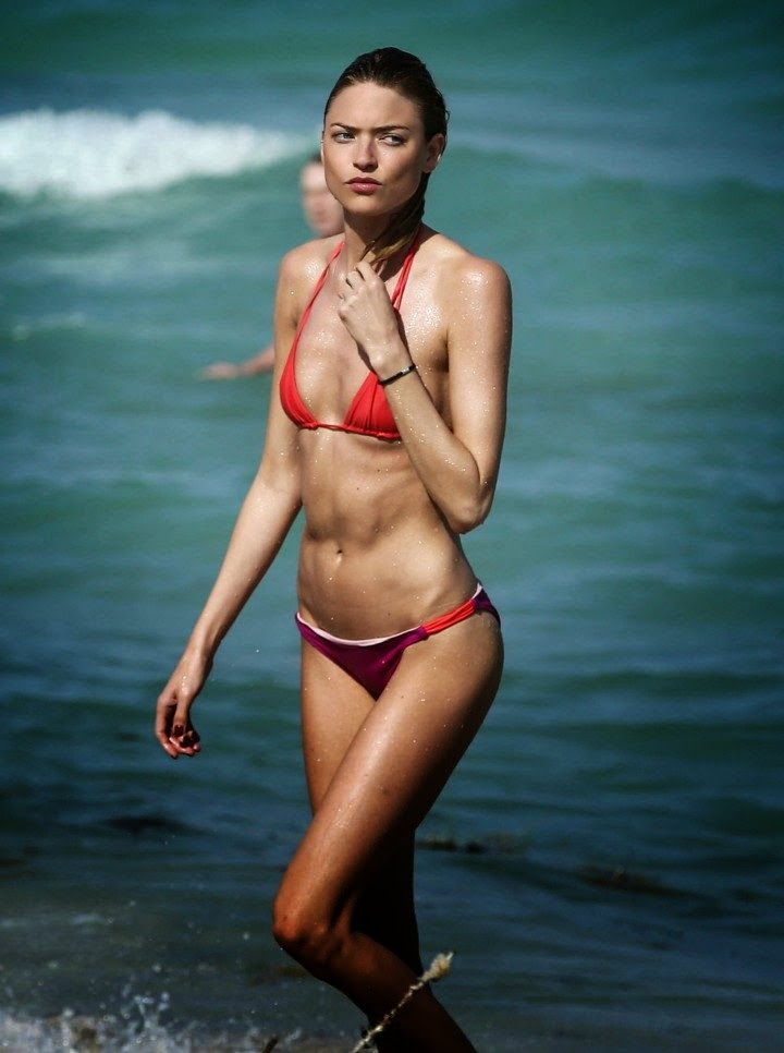 Martha Hunt struggles in a Red Bikini as she practices her diamond curves in Miami