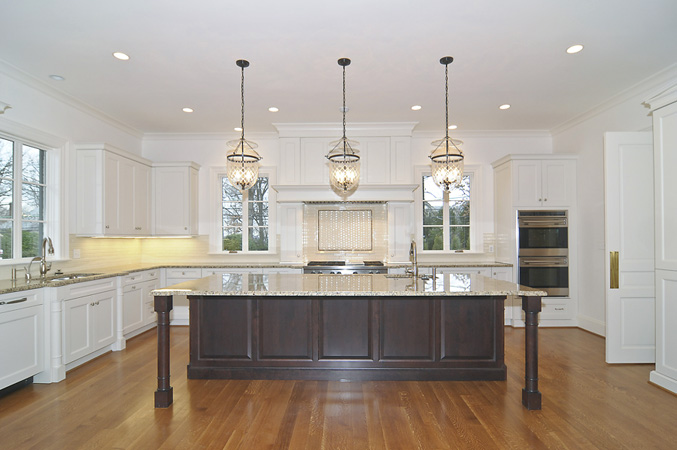 and Garden Design Espresso Islands with Banks of Tall White Cabinets