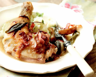 Chicken and Apple Casserole: Chicken pieces stewed with apples and bacon in a chicken stock and cider base served with mashed potatoes and cabbage