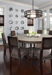Comfortable Wooden Chairs around the Round Dining Tables under Unique Drum Pendant Light and Grey Ceiling
