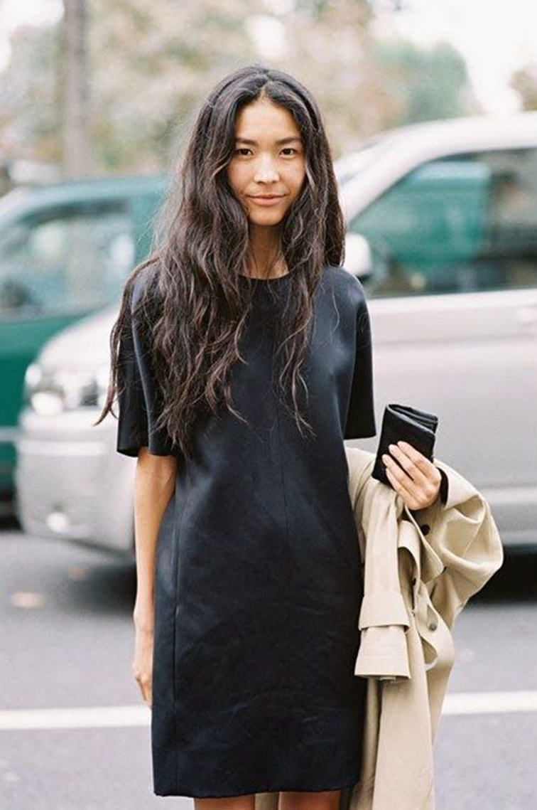 Street style, black leather t-shirt dress, long messy tousled hair, fashion week