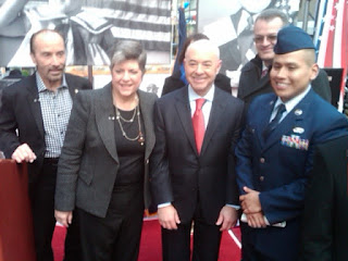 From left: Lee Greenwood, Secretary Napolitano and Director Mayorkas with a naturalized member of the U.S. armed forces